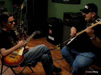 Conrad Oberg playing guitar with Johnny Hiland